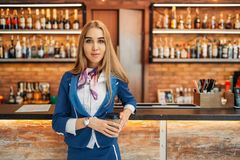 Stewardess at the bar counter in airport cafe royalty free stock photos