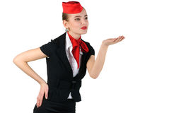 Stewardess blowing a kiss. Young beautiful stewardess blowing  a kiss Stock Images