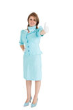 Stewardess in blue uniform gesturing thumbs up Stock Photo