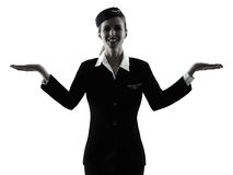 Stewardess cabin crew woman  hands open isolated silhouette Royalty Free Stock Images