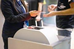 Stewardess checks the ticket and passport stock photo