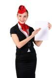 Stewardess, der auf Papier zeigt Lizenzfreies Stockbild
