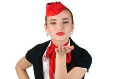 Stewardess, der einen Kuss durchbrennt Lizenzfreie Stockfotografie