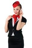 Stewardess, der am Telefon spricht Stockfoto