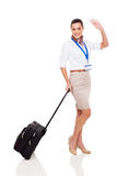 Stewardess die vaarwel golven Stock Afbeeldingen