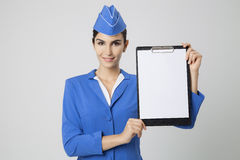 Stewardess Dressed In Blue Uniform with empty blank in hands Royalty Free Stock Images
