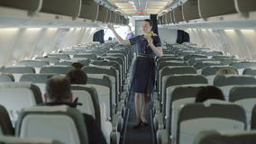 Stewardess explains rules about safety in case of crash airplane stock footage