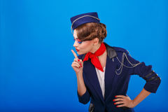 Stewardess with face art asks for silence. Royalty Free Stock Image