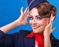 Stewardess with face art corrects hairstyle. Royalty Free Stock Photo