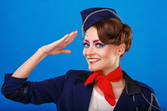 Stewardess with face art salutes. Stock Photos