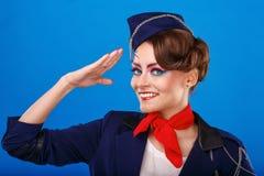 Stewardess with face art salutes. Stock Photos