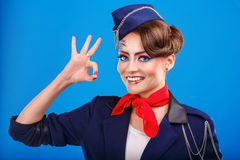 Stewardess with face art shows OK. Royalty Free Stock Photos