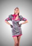 Stewardess gegen die Steigung Stockfotos