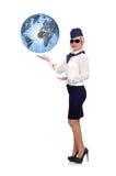 Stewardess holding globe Stock Image
