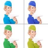 Stewardess Holding Paper Plane in der Hand. Mit Farbvarianten Lizenzfreie Stockbilder