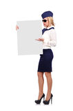 Stewardess holding placard Royalty Free Stock Photography
