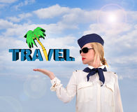 Stewardess holding travel symbol Royalty Free Stock Image