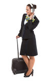 Stewardess with a luggage bag Royalty Free Stock Image