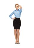 Stewardess making greeting gesture Royalty Free Stock Image
