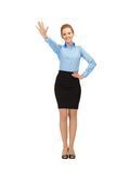 Stewardess making greeting gesture Stock Photos