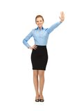 Stewardess making greeting gesture Royalty Free Stock Photography