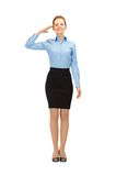 Stewardess making salute gesture Royalty Free Stock Photo