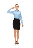 Stewardess making salute gesture Royalty Free Stock Image