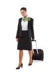 Stewardess met bagagezakken stock foto's