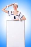 Stewardess met lege raad Stock Afbeelding
