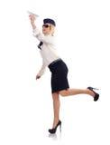 Stewardess mit Papierflugzeug Stockfotografie