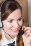 Stewardess nelle cuffie fotografia stock libera da diritti