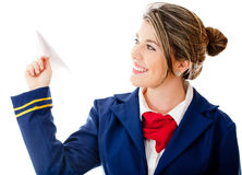 Stewardess with a paper airplane Royalty Free Stock Photo
