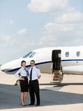 Stewardess And Pilot Standing Together Against Stock Photography