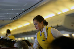 Stewardess on the plane Royalty Free Stock Photography