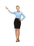 Stewardess pointing her finger Royalty Free Stock Photos
