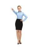 Stewardess pointing her finger Royalty Free Stock Photo
