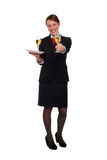 Stewardess serving drinks Stock Image