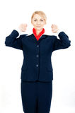 Stewardess showing the exit Royalty Free Stock Photography