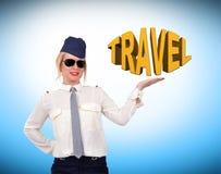 Stewardess showing travel symbol Fotografía de archivo