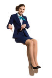 Stewardess Is Sitting On A Banner And Pointing Down Royalty Free Stock Images