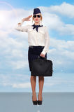 Stewardess standing on runway Royalty Free Stock Images