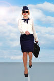 Stewardess walking on runway Royalty Free Stock Images