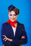 Stewardess With Face Art Meets Passengers. Royalty Free Stock Images