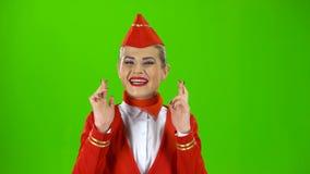 Stewardessen korsade henne fingrar grön skärm lager videofilmer