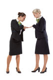 Stewardesses show each other a manicure Royalty Free Stock Image