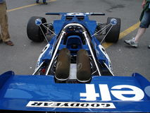 Stewart's Tyrrell 001. 1970 Tyrrell 001 driven by Jackie Stewart and Peter Revson in the formula one world championship. This car has been photographed behind Royalty Free Stock Photo