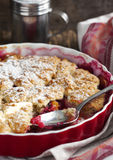 Stewed apple, plum and coconut cobbler. Stock Photo