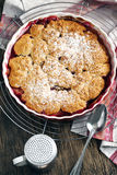 Stewed apple, plum and coconut cobbler. Top view royalty free stock images