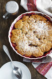 Stewed apple, plum and coconut cobbler Stock Photography