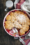 Stewed apple, plum and coconut cobbler. Top view stock photography